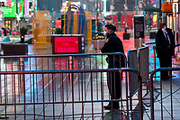 NEW YORK, NY - April 13:  A NYPD officer wears a mask as he stands guard at Times Square during a rainy day on April 13, 2020. in New York, United States. The global economy is facing the worst collapse since the WWII, while COVID-19  pandemic has now killed more than 22,000 people in the United States and at least 1,864,629 people died world wide. (Photo by Eduardo MunozAlvarez/VIEWpress)
