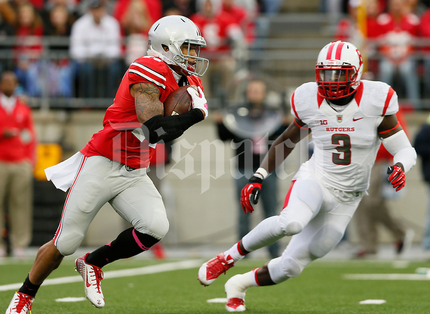 Ohio State Buckeyes running back Jalin Marshall (17) carries the ball while pursued by Rutgers Scarlet Knights linebacker Steve Longa (3) during Saturday's NCAA Division I football game between the Ohio State Buckeyes and the Rutgers Scarlet Knights at Ohio Stadium in Columbus. the Buckeyes led at halftime 35-7. (Dispatch Photo by Barbara J. Perenic)