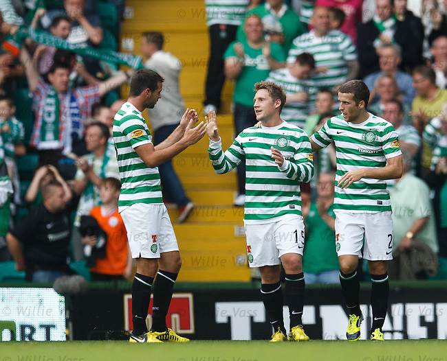 Kris Commons celebrates with Adam Matthews and Joe Ledley after scoring for Celtic