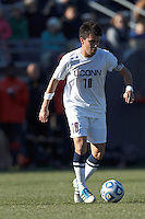 University of Connecticut midfielder Carlos Alvarez (10) at midfield. .NCAA Tournament. University of Connecticut (white) defeated Northeastern University (black), 1-0, at Morrone Stadium at University of Connecticut on November 18, 2012.