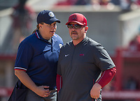 NWA Democrat-Gazette/BEN GOFF @NWABENGOFF<br /> Matt Meuchel, Arkansas assistant coach, talks to home plate umpire Leah Bowen Daume after a call in the 4th inning vs South Carolina Sunday, March 17, 2019, at Bogle Park in Fayetteville.