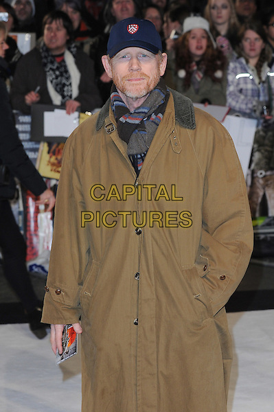 Ron Howard.The UK Premiere of 'Django Unchained', Empire Leicester Square, London, England..January 10th 2013.half length brown camel trenchcoat trench coat hands in pockets scarf hat baseball cap beard facial hair blue grey gray.CAP/BEL.©Tom Belcher/Capital Pictures.