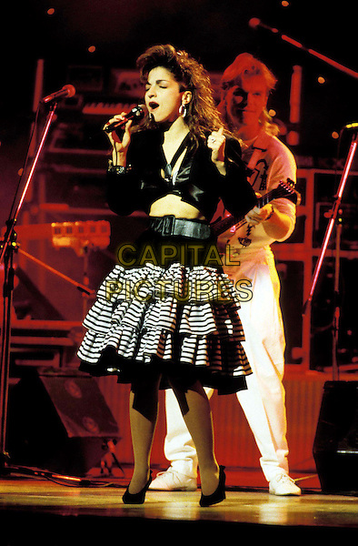 GLORIA ESTEFAN..Ref: 026 ..ra-ra skirt, singing, stage, concert, performance, live, eighties fashion disaster, full length, full-length..www.capitalpictures.com..sales@capitalpictures.com..©Capital Pictures