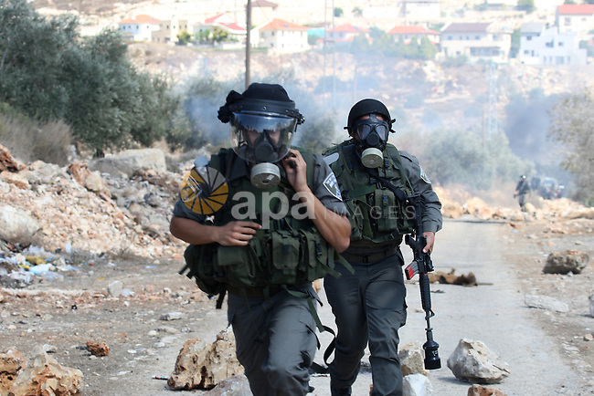 Israeli soldiers clash with Palestinian stone throwers on September 30, 2011 in the West Bank village of Kfar Kadum. Photo by Wagdi Eshtayah