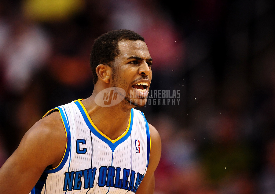 Mar. 25, 2011; Phoenix, AZ, USA; New Orleans Hornets guard Chris Paul celebrates a basket in the fourth quarter against the Phoenix Suns at the US Airways Center. The Hornets defeated the Suns 106-100. Mandatory Credit: Mark J. Rebilas-