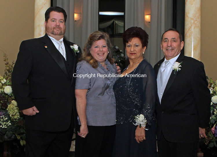WATERBURY, CT-26 January 012613MK26 ( from left) Steve Mulhall with his wife Donna Marie Mirabilio, president women's Ponte Club and Teresa with her husband Antonio Rubbo president, Pontelandolfo Community Club gathered at the gala to install new officers at the Pontelandolfo Club in Waterbury on Saturday night. Michael Kabelka / Republican-American