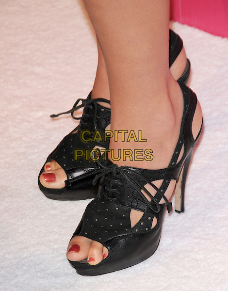 COLBIE CAILLAT's shoes.The Annual US Weekly Hot Hollywood Event held at The Colony in Hollywood, California, USA..November 18th, 2010.detail red nail varnish polish slingback  black open toe shoes  .CAP/RKE/DVS.©DVS/RockinExposures/Capital Pictures.