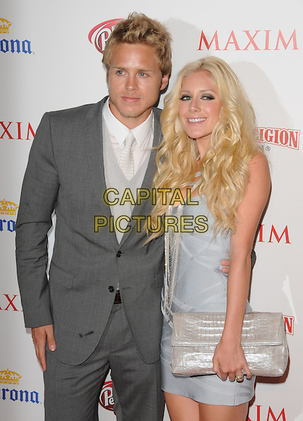 SPENCER PRATT & HEIDI MONTAG.The Maxim's Hot 100 List Party held at Barker Hangar in Santa Monica, California, USA..May 13th, 2009.half length grey gray suit silver blue dress couple clutch bag.CAP/DVS.©Debbie VanStory/Capital Pictures.