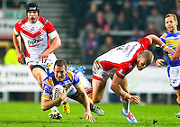 Picture by Alex Whitehead/SWpix.com - 28/03/2014 - Rugby League - First Utility Super League - St Helens v Leeds Rhinos - Langtree Park , St Helens, England - Leeds' Danny McGuire is tackled by St Helens' Josh Jones.