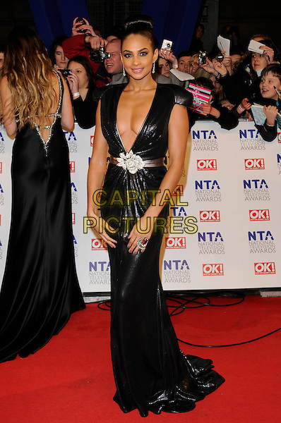 ALESHA DIXON.National Television Awards at the O2 Arena, London, England..January 26th 2011.arrivals NTA NTAs full length black sequined sequin low cut long maxi dress plunging neckline belt cleavage shiny buckle maxi belt white rose flower.CAP/FIN.©Steve Finn/Capital Pictures.