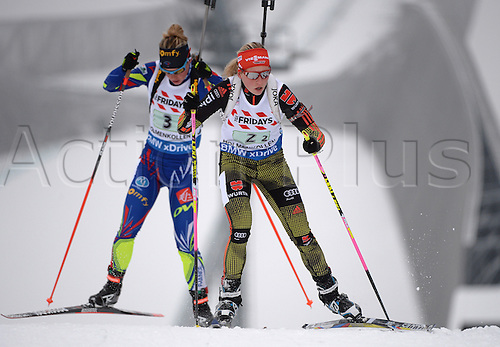 03.03.2016. Holmenkollen, Oslo, Norway.  (R-L) Franziska Hildebrand of Germany and Marie Dorin Habert of France during the mixed relay competition at the Biathlon World Championships, in the Holmenkollen Ski Arena, Oslo, Norway, 03 March 2016.