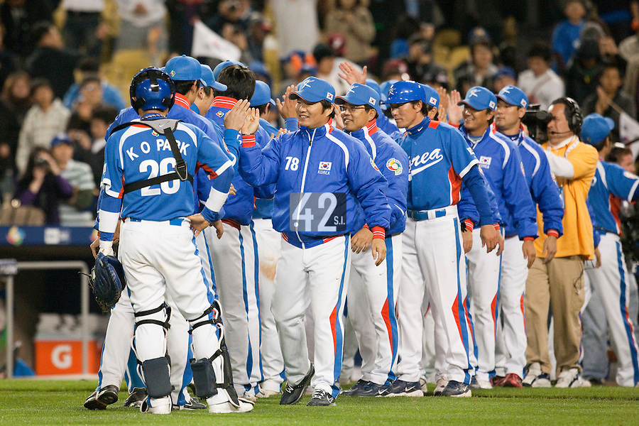 21 March 2009: Team Korea celebrate at the end of the 2009 World Baseball Classic semifinal game at Dodger Stadium in Los Angeles, California, USA. Korea wins 10-2 over Venezuela.