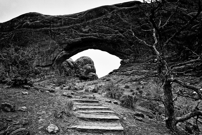 Black and white image of trail leading to North Window arch in Arches National Park, UT