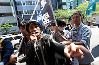 Yuhimaru Takeda (left) and Ikumi Saito (right) protesting at a Zengakuren student union demo at Hosei University Campus. Ichigaya, Tokyo, Japan. Friday April 25th 2014