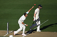 Trent Boult bowling.<br /> New Zealand Blackcaps v England. 1st day/night test match. Eden Park, Auckland, New Zealand. Day 4, Sunday 25 March 2018. &copy; Copyright Photo: Andrew Cornaga / www.Photosport.nz