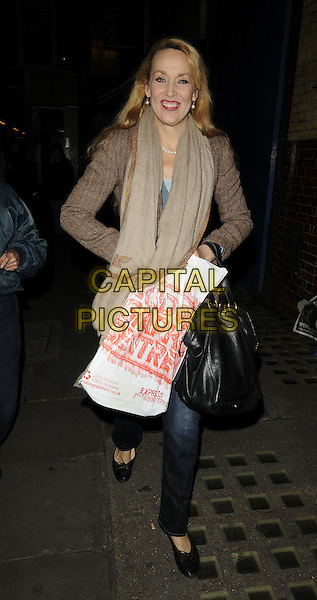 "JERRY HALL.Leaving the theatre after performing in ""Calendar Girls"", Noel Coward Theatre, London, England, UK, .October 30th 2009..full length brown jacket scarf beige black bag jeans walking ballet pumps flats shoes .CAP/CAN.©Can Nguyen/Capital Pictures"