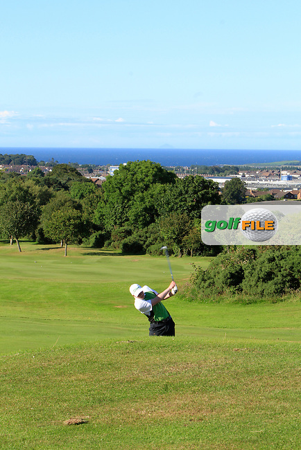 Sam Sweeney (Seapoint) on the 18th during the Ulster Boys' Amateur Open Championship in Clandeboye Golf Club on Tuesday 8th July 2014.<br /> Picture:  Thos Caffrey / www.golffile.ie
