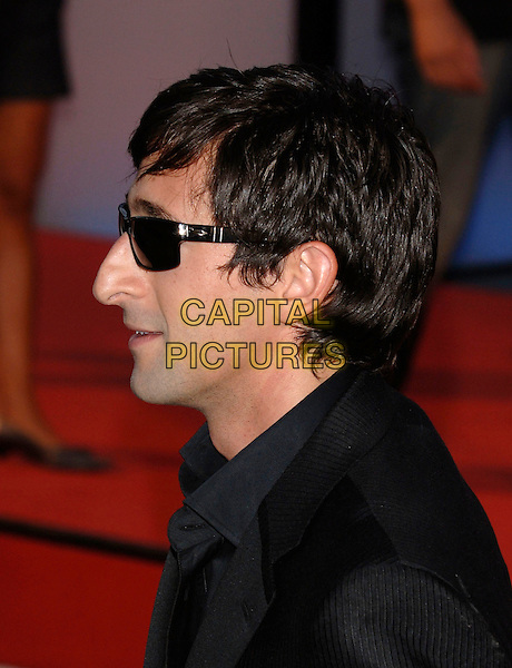 """ADRIEN BRODY.""""Hollywoodland"""" premiere on the second day of the 63rd Venice International Film Festival, Venice, Italy..August 31st, 2006.Ref: PL.Adrian headshot portrait sunglasses shades profile.www.capitalpictures.com.sales@capitalpictures.com.©Phil Loftus/Capital Pictures"""