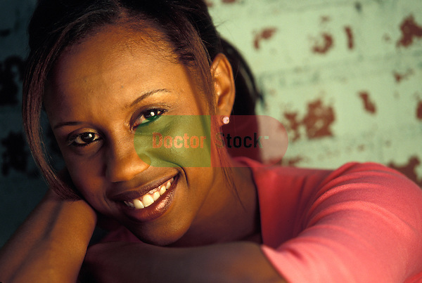 attractive black woman smiling at camera