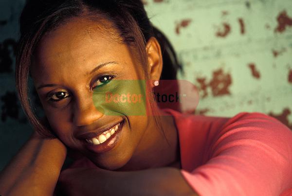 attractive black woman smiling at camera