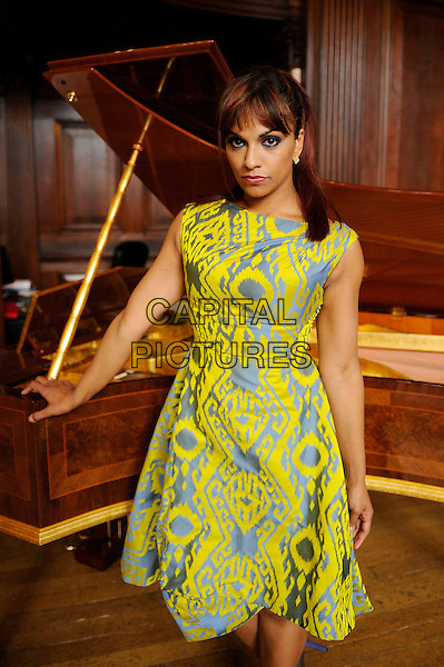 LONDON, ENGLAND - JULY 16: Danielle De Niese performing a showcase after being announced as an 'IRC Voice' of The International Rescue Committee at Yamaha Music on July 16, 2014 in London, England.<br /> CAP/MAR<br /> &copy; Martin Harris/Capital Pictures