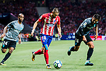 Yannick Ferreira Carrasco (l) of Atletico de Madrid is tackled by Jose Luis Garcia del Pozo, Recio, of Malaga CF  during the La Liga 2017-18 match between Atletico de Madrid and Malaga CF at Wanda Metropolitano on 16 September 2017 in Madrid, Spain. Photo by Diego Gonzalez / Power Sport Images