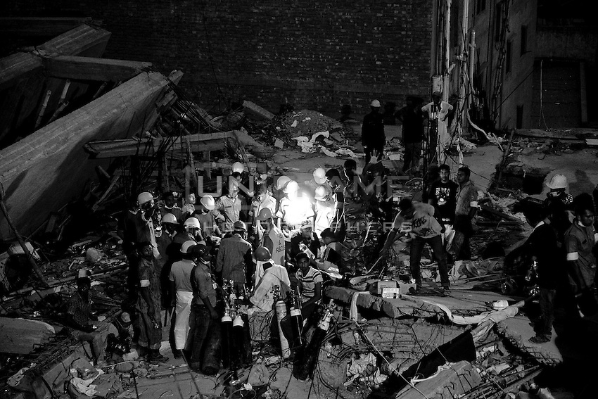 Rescue workers look for trapped garment workers in the collapsed Rana Plaza building in Savar, Dhaka, Bangladesh