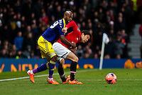Sunday 05 January 2014<br /> Pictured:Luke Moore battles with Shinji Kagawa of Manchester United<br /> Re: Manchester Utd FC v Swansea City FA cup third round match at Old Trafford, Manchester