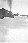 New Mexico Lumber Co. engine (ex-D&amp;RGW #349) pushing the wedge snowplow through some moderately deep snow.<br /> New Mexico Lumber Co.  San Juan National Forest, CO  Taken by Long, Morris - ca. 1928