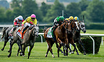 ELMONT, NY - JUNE 09: The field of the Longines Just A Game battle it out in the stretch on Belmont Stakes Day at Belmont Park on June 9, 2018 in Elmont, New York. (Photo by Eric Patterson/Eclipse Sportswire/Getty Images)