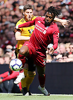 Liverpool's Divock Origi shields the ball from Wolverhampton Wanderers' Matt Doherty<br /> <br /> Photographer Rich Linley/CameraSport<br /> <br /> The Premier League - Liverpool v Wolverhampton Wanderers - Sunday 12th May 2019 - Anfield - Liverpool<br /> <br /> World Copyright © 2019 CameraSport. All rights reserved. 43 Linden Ave. Countesthorpe. Leicester. England. LE8 5PG - Tel: +44 (0) 116 277 4147 - admin@camerasport.com - www.camerasport.com