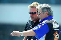 Apr. 15, 2012; Concord, NC, USA: NHRA track specialist Tommy Johnson Jr (left) with crew chief Tommy DeLago during eliminations for the Four Wide Nationals at zMax Dragway. Mandatory Credit: Mark J. Rebilas-