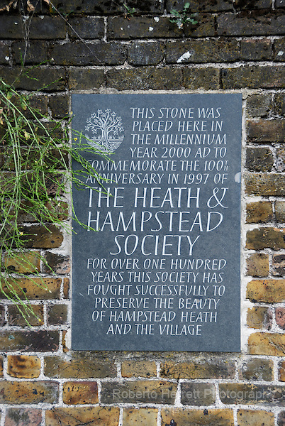 Stone wall plaque commemorating 100 years of the Heath and Hampstead Society, Hampstead, London, England
