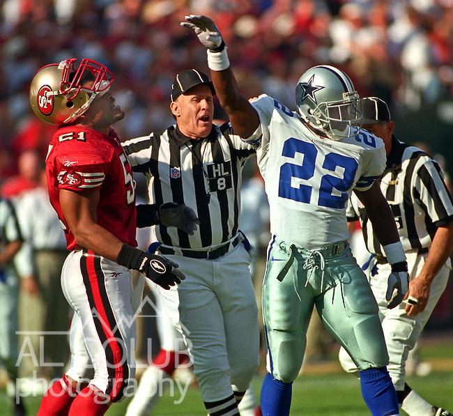 San Francisco 49ers vs. Dallas Cowboys at Candlestick Park Sunday, November 10, 1996.  Cowboys beat 49ers  20-17.  Dallas Cowboys running back Emmitt Smith (22) flips San Francisco 49ers linebacker Ken Norton (51) in the face.