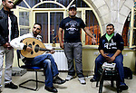 "Rappers ""City Ghosts"", the twins Mustafa (1st R) and Ali (2nd R) Jabr, perform especiallly for the event with a group of traditional singers and oud-player . during ""Al Quds Underground""-festival. Palestinian musicians, actors and artists from Jerusalem showcased their work inside private homes, mainly in the Islamic Qurater within the Old City walls. .Photo by Quique Kierszenbaum.."