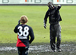 Essendon's players took the opportunity to engage in a bit of horseplay before training, capturing and rolling fitness trainer Justin Cordy in the thick mud in the centre of Windy Hill oval.