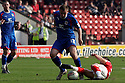 Joel Byrom of Stevenage tackled. - Walsall v Stevenage - npower League 1 - Banks's Stadium, Walsall - 24th March, 2012  .© Kevin Coleman 2012