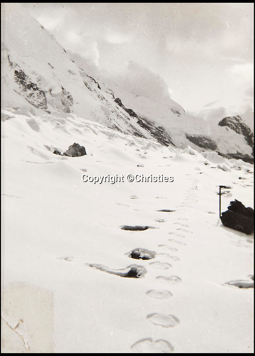 BNPS.co.uk (01202 558833)<br /> Pic: Christies/BNPS<br /> <br /> A picture showing 'Yeti' footprints in the Himalayas.<br /> <br /> The first photographs showing what is believed to be the famous 'Yeti' have emerged for sale.<br /> <br /> British explorer Eric Earle Shipton took the historical pictures in 1951 when he was trekking at 19,000ft in the Himalayas.<br /> <br /> He spotted the mysterious 13-inch footprint in the snow and his iconic photograph caused a global stir, which has divided explorers and historians for decades.