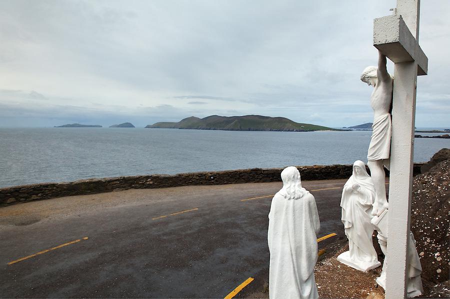 Dingle Slea Head Crucifix with Blasket Islands in background, Slea Head Drive, Dingle Peninsula, County Kerry, Republic of Ireland
