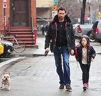 Hugh Jackman and Ava Jackman and their dog walking in New York City