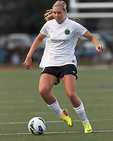 Portland Thorns FC midfielder Allie Long (10) passes the ball.  In a National Women's Soccer League (NWSL) match, Boston Breakers (blue) defeated Portland Thorns FC (white/black), 2-1, at Dilboy Stadium on August 7, 2013.