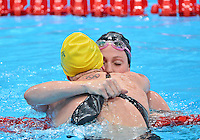 July 30, 2012..Missy Franklin embraces Emily Seebohm after winning Women's 100m Backstroke Final at the Aquatics Center on day three of 2012 Olympic Games in London, United Kingdom.