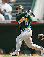 Frank Menechino of the Oakland Athletics bats during a 2002 MLB season game against the Los Angeles Angels at Angel Stadium, in Anaheim, California. (Larry Goren/Four Seam Images)