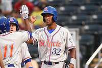 St. Lucie Mets outfielder Eudy Pina (32) congratulates Maikis De La Cruz (11) after hitting a home run during a game against the Fort Myers Miracle on April 18, 2014 at Hammond Stadium in Fort Myers, Florida.  St. Lucie defeated Fort Myers 15-9.  (Mike Janes/Four Seam Images)