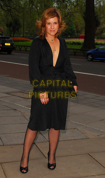 HARRIET SCOTT.Arrivals at the Sony Radio Academy Awards 2006 at Grosvenor House Hotel, London, UK..May 8th, 2006.Ref: CAN.full length black dress plunging neckline clutch purse.www.capitalpictures.com.sales@capitalpictures.com.© Capital Pictures.