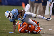 Charlotte, NC - December 5, 2015: Quinshad Davis, of the North Carolina Tar Heels, is tackled by Van Smith, #23 of the Clemson Tigers, in the ACC Football Championship game between the North Carolina Tar Heels and the Clemson Tigers at the Bank of America Stadium in Charlotte, North Carolina, December 5, 2015. Clemson defeated North Carolina 45-37.  (Photo by Don Baxter/Media Images International)