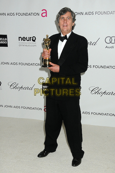 John Midgley.20th Annual Elton John Academy Awards Viewing Party held at West Hollywood Park, West Hollywood, California, USA..February 26th, 2012.full length tuxedo award trophy winner black  .CAP/ADM/BP.©Byron Purvis/AdMedia/Capital Pictures.