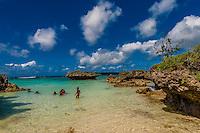 Kanak (Melanesian) family at the beach, Roh Seday Home Stay, North Bay, island of Mare, Loyalty Islands, New Caledonia