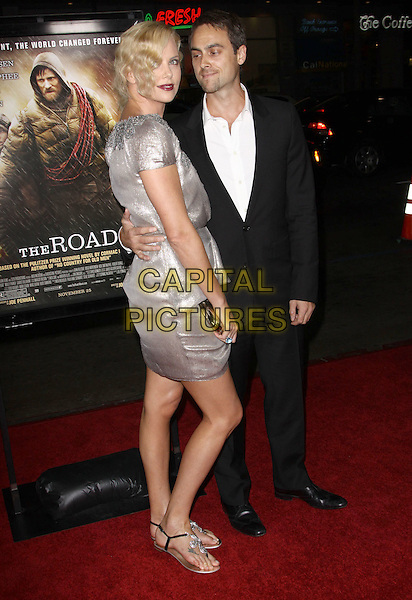"""CHARLIZE THERON & STUART TOWNSEND.AFI FEST 2009 Screening Of """"The Road"""" held At The Grauman's Chinese Theatre, Hollywood, California, USA..November 4th, 2009.full length grey gray silver wrap dress lace beads beaded clutch bag sandals flat black suit white shirt couple arm around waist .CAP/ADM/KB.©Kevan Brooks/AdMedia/Capital Pictures."""