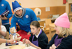 St Johnstone players took some festive cheer to Fairview School in Perth gving out selection boxes and gifts to the pupils&hellip;David Wotherspoon hands over a saints teddy bear to secondary school pupil Emily<br />